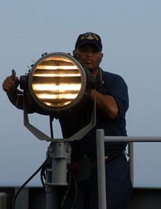 Seaman_send_Morse_code_signals